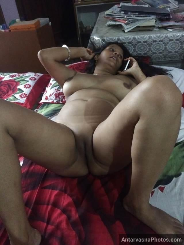 nude indian bhabhi laying on bed and enjoying sex chat with lover